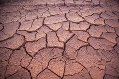 Droge en gebarsten modder dicht omhoog in Thailand royalty-vrije stock fotografie