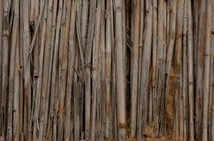 Droge riet en kleitextuur van een modderhut van structuur bruine dichte omhooggaand stock foto