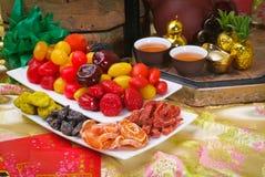 Droge vruchten met Chinees nieuw jaar BG royalty-vrije stock foto's