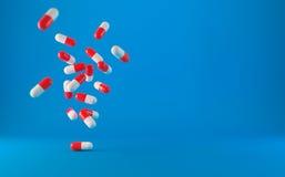 Droghe mediche delle pillole che cadono Fotografie Stock