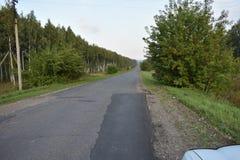 Drogi zmielona asfaltowa droga Zdjęcia Stock