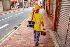 Drogowy pracownik w Hong kong ulicie fotografia royalty free