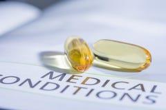 Drogue de capsule sur les soins de santé de concept de livre photo libre de droits