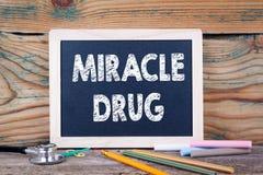 Drogue de miracle Concept de santé Tableau sur un fond en bois Photos libres de droits