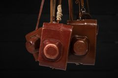 Drohobych, Ukraine - 03 February, 2019: Heap of 35mm retro cameras in leather covers, top view stock image