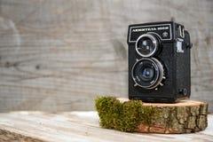 Drohobych, Ukraine - January 20, 2018: Old soviet vintage camera on wooden stand, wooden background, retro theme, auctions and hob. Old vintage camera on wooden Stock Image