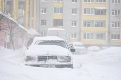 Drohobych, Ukraine - March15, 2013: Mercedes-benz and other cars blocked by snow, snow-paralysis of traffic, snow covered street, Royalty Free Stock Images