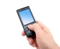 droite de téléphone portable de main noire Photographie stock
