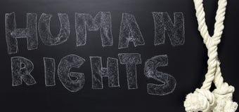 Droits de l'homme écrits avec la corde sur le tableau noir Images libres de droits