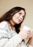 Dromende dame met kop thee Stock Afbeelding