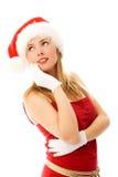 Dromerig meisje dat de hoed van de Kerstman draagt Royalty-vrije Stock Foto's