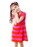 Dromerig meisje in roze kleding Stock Foto