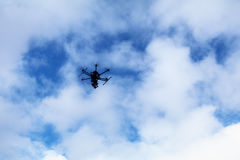 Dron. In the air. Flying on blue sky Stock Photos