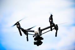 Dron DJI Inspire 1. Quadcopter fly in sky stock image