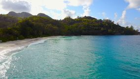 Dron is flying along the beach, Seychelles. Aerial view of Anse Intendance in Mahe`, Seychelles. Dron is flying over the sea. Luxury island resort on exotic stock video
