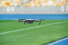 Dron is flying over football field royalty free stock photography