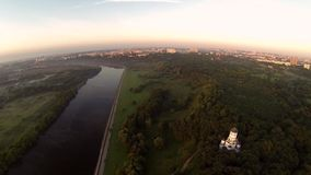 Dron video a chapel near the river at sunset stock footage