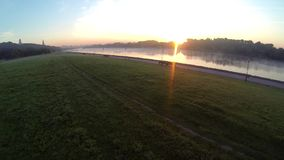 Dron video dawn on a river, morning smoke on a river stock footage
