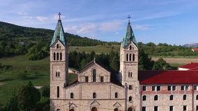 Drone aerial circular view of the Guca Gora church tower in Franciscan monastery,. Drone aerial circular view of the Guca Gora church tower in Franciscan stock video footage