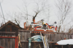 Drone in aerial flight on countryside. Modern technologies for capturing photo and video Royalty Free Stock Images