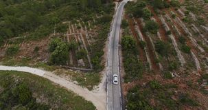 Drone aerial following a car through mountain road stock footage