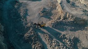 4K drone aerial footage. Fly around excavator in a mountain stone quarry. Drone aerial footage. Fly around excavator in a mountain stone quarry stock video