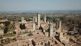 Drone aerial footage of the wonderful village of San Gimignano. A Unesco World Heritage. Tuscany, Italy. Spring time stock footage