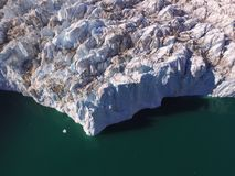 Drone aerial image of ice protruding from the terminus of a glacier in northeast Greenland into ocean waters in a fjord. Drone aerial image acquired during a stock photography