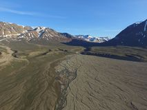 Drone aerial image of meltwater streams merging in a fluvial river valley in northeast Greenland. Drone aerial image acquired during a research cruise in royalty free stock photography