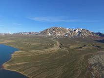 Drone aerial image of a river valley in a fjord in Northeast Greenland with snowy mountains in the background. Drone image acquired during a research cruise in royalty free stock images