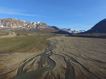 Drone aerial image of twisting, winding, streams in a fluvial river valley in northeast Greenland. Drone aerial image acquired during a research cruise in royalty free stock photos