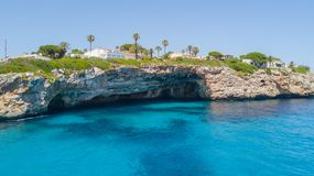 Drone aerial landscape of the beautiful bay of Cala Anguila with a wonderful turquoise sea, Porto Cristo, Majorca. Spain Stock Photos