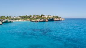 Drone aerial landscape of the beautiful bay of Cala Anguila with a wonderful turquoise sea, Porto Cristo, Majorca. Spain Royalty Free Stock Photos