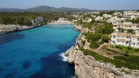 Drone aerial landscape of the beautiful bay of Cala Estany d`en Mas with a wonderful turquoise sea, Majorca, Spain. Drone aerial landscape of the beautiful bay stock video footage