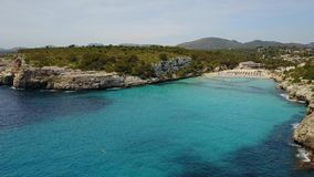 Drone aerial landscape of the beautiful bay of Cala Estany d`en Mas with a wonderful turquoise sea, Majorca, Spain. Drone aerial landscape of the beautiful bay stock footage
