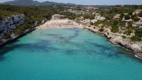 Drone aerial landscape of the beautiful bay of Cala Estany d`en Mas with a wonderful turquoise sea, Cala Romantica, Porto Cristo. Majorca, Spain stock video footage