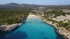 Drone aerial landscape of the beautiful bay of Cala Estany d`en Mas with a wonderful turquoise sea, Cala Romantica, Porto Cristo. Majorca, Spain stock video footage