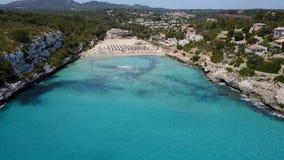 Drone aerial landscape of the beautiful bay of Cala Estany d`en Mas with a wonderful turquoise sea, Cala Romantica, Porto Cristo. Majorca, Spain stock footage