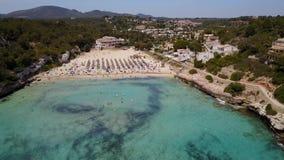Drone aerial landscape of the beautiful bay of Cala Estany d`en Mas with a wonderful turquoise sea, Cala Romantica, Porto Cristo. Majorca, Spain stock video