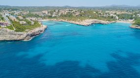 Drone aerial landscape of the beautiful bay of Cala Mandia and Anguila with a wonderful turquoise sea, Porto Cristo, Majorca. Spain. Summer time Royalty Free Stock Image