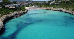 Drone aerial landscape of the beautiful bay of Cala Mandia with a wonderful turquoise sea, Porto Cristo, Majorca. Spain stock footage