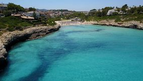 Drone aerial landscape of the beautiful bay of Cala Mandia with a wonderful turquoise sea, Porto Cristo, Majorca. Spain stock video footage