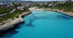 Drone aerial landscape of the beautiful bay of Cala Mandia with a wonderful turquoise sea, Porto Cristo, Majorca. Spain stock footage