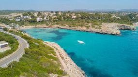 Drone aerial landscape of the beautiful bay of Cala Mandia with a wonderful turquoise sea, Porto Cristo, Majorca, Spain. Summer time Stock Photo