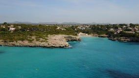 Drone aerial landscape of the beautiful bay of Cala Mandia with a wonderful turquoise sea, Porto Cristo, Majorca, Spain. Summer time stock footage