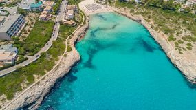 Drone aerial landscape of the beautiful bay of Cala Mandia with a wonderful turquoise sea, Porto Cristo, Majorca, Spain. Summer time Stock Images