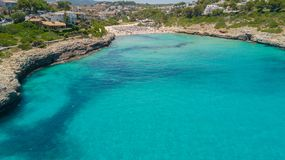 Drone aerial landscape of the beautiful bay of Cala Mandia with a wonderful turquoise sea, Porto Cristo, Majorca, Spain. Summer time Stock Photography
