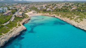 Drone aerial landscape of the beautiful bay of Cala Mandia with a wonderful turquoise sea, Porto Cristo, Majorca, Spain. Summer time Stock Image