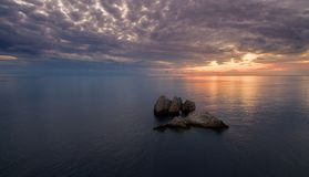 Drone aerial shot of a Beautiful sunset at the coast of central Corfu Greece.  Stock Photos