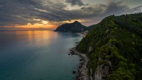 Drone aerial shot of a Beautiful sunset at the coast of central Corfu Greece.  Royalty Free Stock Photo
